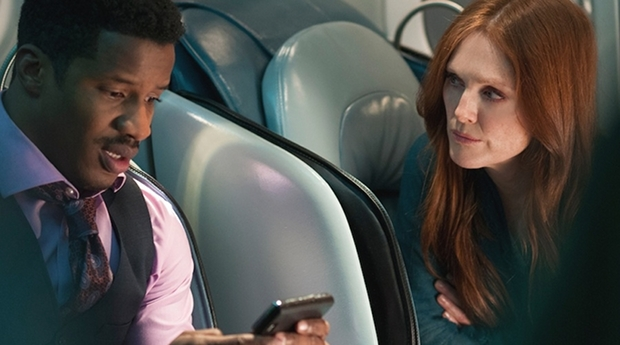 Nate-Parker-and-Juilanne-Moore-in-Non-Stop-2014