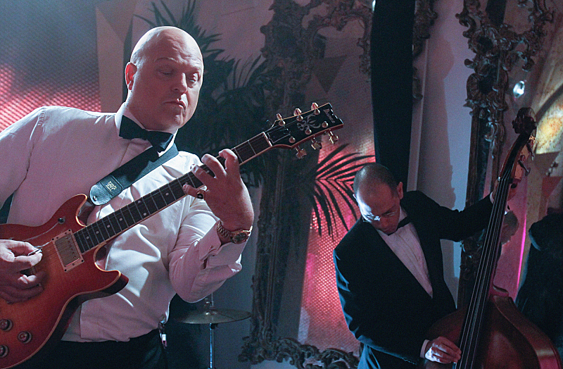 """""""Past Lives"""" --Michael Chiklis takes a break between scenes to jam with the band, on VEGAS Friday, April 26 (9:00-10:00 PM, ET/PT) on the CBS Television Network. Photo: Cliff Lipson/CBS © 2013 CBS Broadcasting, Inc. All Rights Reserved."""