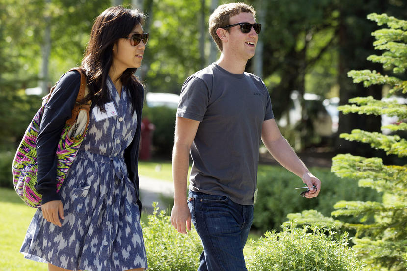 FILE - In this July 9, 2011 file photo, Facebook president and CEO Mark Zuckerberg, right, walks to morning sessions with Priscilla Chan during the Allen and Co. Sun Valley Conference, in Sun Valley, Idaho. Zuckerberg and his wife, Chan, are donating $25 million to the CDC Foundation to help address the Ebola epidemic, the foundation said Tuesday, Oct. 14, 2014. (AP Photo/Julie Jacobson, File)