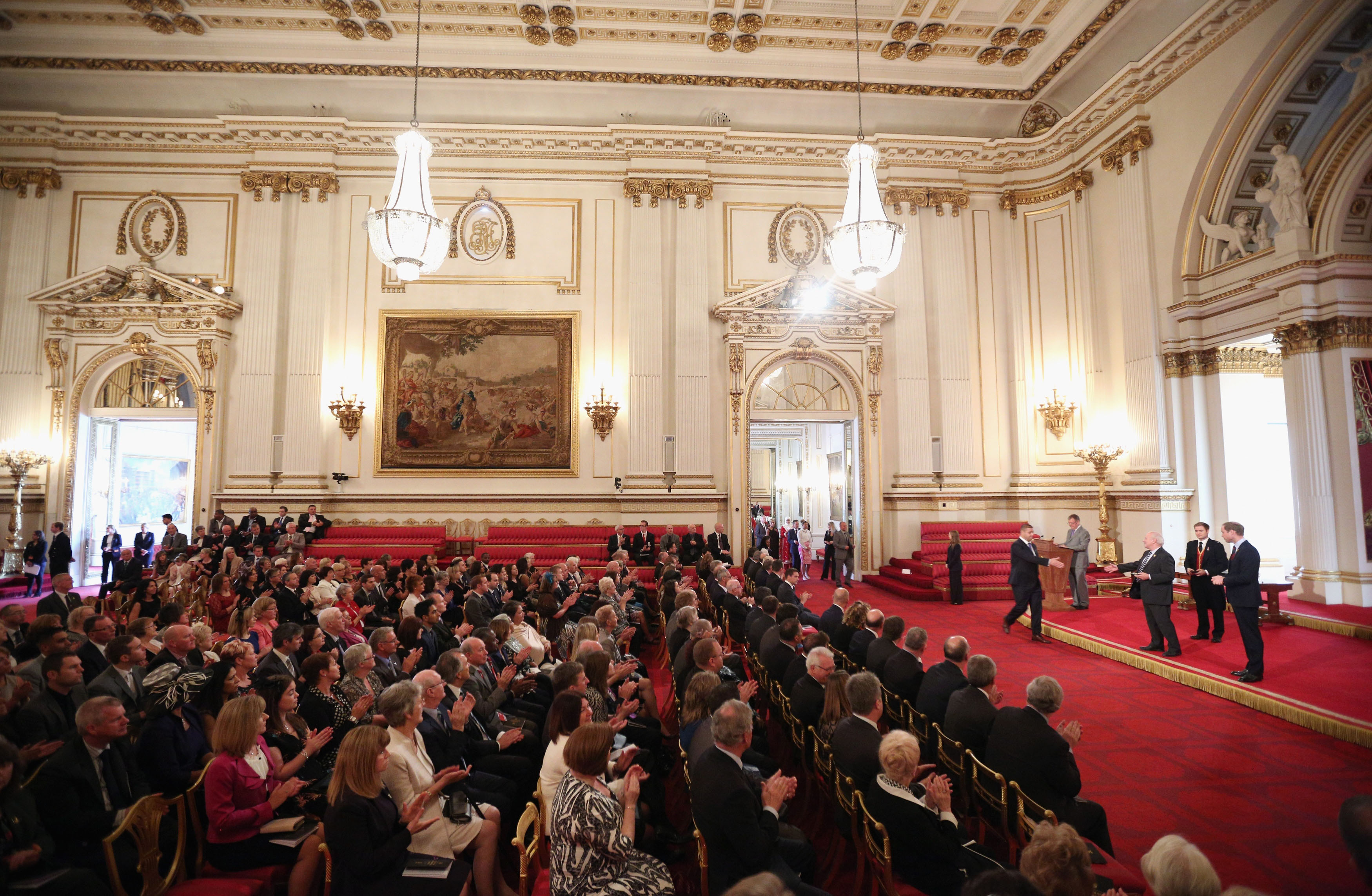 LONDON, ENGLAND - OCTOBER 07: Prince William, Duke of Cambridge, in his role as President of The Football Association, and Greg Dyke, the Chairman of the FA, award medals to the FA's 150 Grassroots Heroes in the Ballroom of Buckingham Palace on October 7, 2013 in London, England. 150 volunteers who work to support grassroots football. were presented with a medal by The Duke of Cambridge and Greg Dyke, the Charmian of the Football Association. To celebrate 150 years of the FA, an official Southern Amateur League fixture football match will take place in the grounds of Buckingham Palace between two of the oldest amateur clubs in England. The match will be played between Civil Service FC, the sole surviving club from the eleven that met to create The FA in 1863, and Polytechnic FC, which was formed in 1875.. (Photo by Oli Scarff - WPA Pool /Getty Images)