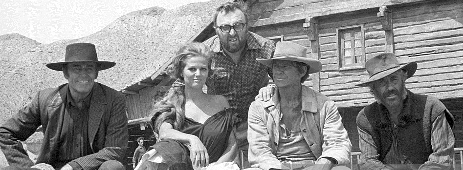 American actor Henry Fonda, Italian actress Claudia Cardinale, Italian director Sergio Leone, American actor Charles Bronson (Charles Buchinsky) and American actor Jason Robards posing on the set of the film Once Upon a Time in the West. 1968