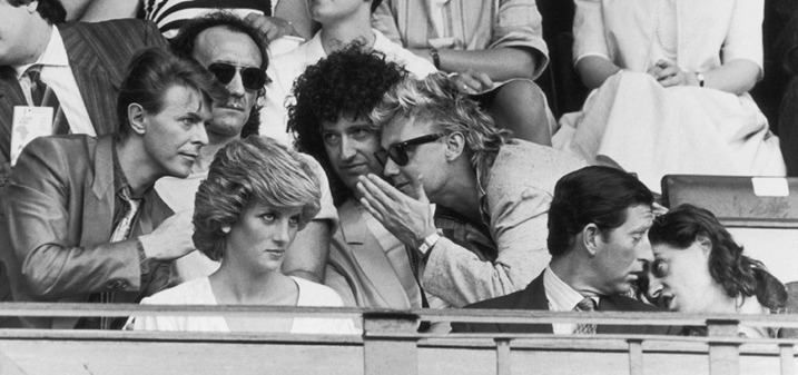 Bob Geldof has a word with Prince Charles, while David Bowie chats with Roger Taylor and Brian May of Queen, during the Live Aid Concert at Wembley Stadium, 13th July 1985. (Photo by Dave Hogan/Hulton Archive/Getty Images)