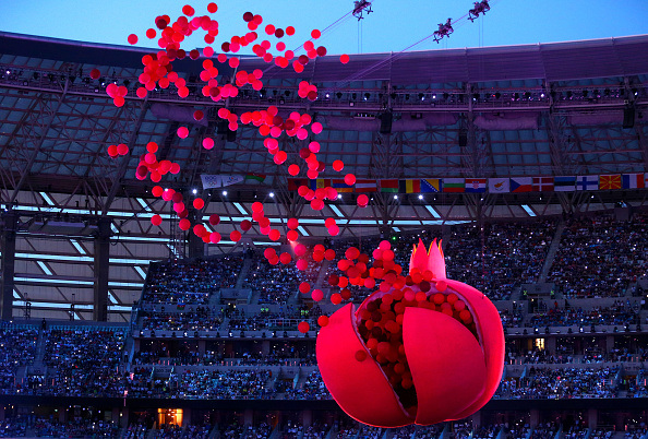 BAKU, AZERBAIJAN - JUNE 12: A giant Pomegranate representing abundance, rebirth, love and good luck splits open to release its seeds during the Opening Ceremony for the Baku 2015 European Games at the Olympic Stadium on June 12, 2015 in Baku, Azerbaijan. (Photo by Robert Prezioso/Getty Images for BEGOC)
