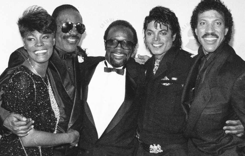 Grammy winners Dionne Warwick, Stevie Wonder, Quincy Jones, Michael Jackson and Lionel Richie pose together backstage at the Grammy Awards show in Los Angeles, on February 26, 1986. (AP Photo)